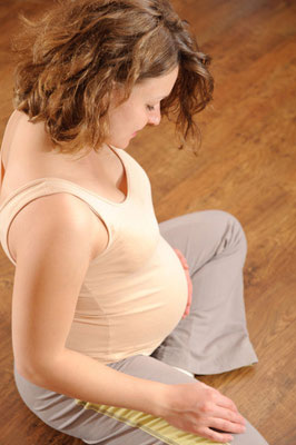 Image of a woman and her bump during Antenatal Yoga Classes in Hitchin
